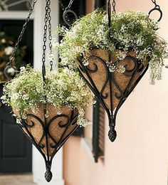 Inspired by an antique design, our Antique Hanging Planter features graceful scrollwork and a wrought-iron look that accentuates your chosen arrangement.