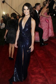 Lea Michele took a dive with a plunging neckline in her gorgeous shiny navy dress on the red carpet of the MET Gala in NYC. See full gallery here: http://bit.ly/ISkhB2