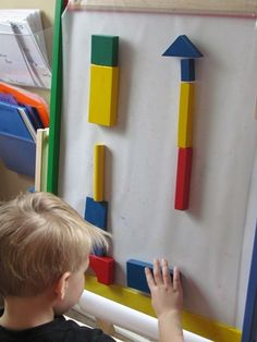 Building with blocks on the sticky easel...
