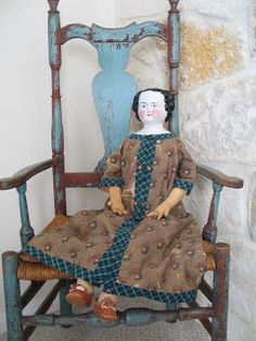 little blue chair and doll