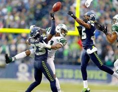 Seattle's defense stood out in its 28-7 win as Marcus Trufant, left, and Richard Sherman, right, break up a pass intended for Jeremy Kerley. (Photo by John Lok / The Seattle Times)