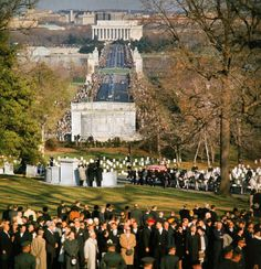 11/25/63 - JFK's final journey, through the winding, wooded paths of Arlington Cemetery to the burial site.