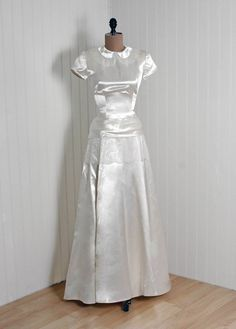 Wedding Gown, Cahill, Beverly Hills: 1940's, shimmer silk satin and Chantilly lace, Peter-Pan collar sculpted drop-waist peplum bodice, backside bustle bow-sash full-length skirt with train.