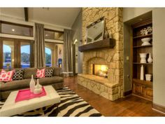 A spectacular fireplace and unique decor. Austin, TX Coldwell Banker United, Realtors $1,249,000