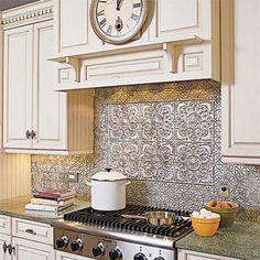 Tin ceiling tile backsplash with antique white cabinets