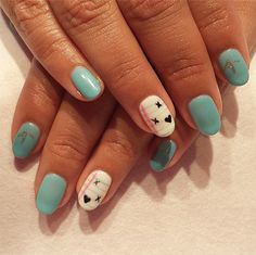 It's easy to make your nails into notebooks! Just use a striping brush for the lines and a nail art pen for the doodles.