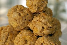 NO BAKE CORN FLAKE COOKIES  1 c. sugar  1 c. corn syrup  1 c. peanut butter  6 c. corn flakes  Bring sugar and syrup to boil. Add peanut butter and corn flakes. Shape into balls; place on waxed paper. Makes 3 dozen.