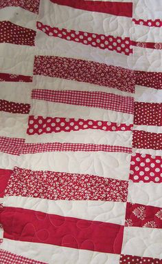 red white quilt..be nice on the wall, too