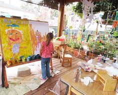 Beautiful place to paint at Palisades Preschool - love the string wall and the really big easel.