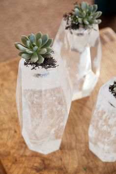 repurpose chunky crystal or glass candleholders as pots for tiny succulents or air plants