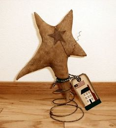 Spring from chair or couch as a stand for flannel star & hang tag