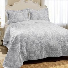 Perfect for your master suite or guest room, this lovely cotton quilt set showcases a scrolling damask motif and reversible design.    ...