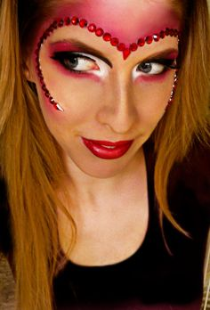 Queen of Hearts--I love this idea of framing the face with a heart design!    #fantasy makeup, Alice in Wonderland, Queen of Hearts, red makeup, jewels, eye makeup