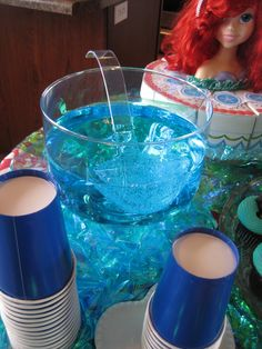 2 Bottles of Sprite & 2 drops of blue food coloring. Perfect for Under The Sea Birthday theme.