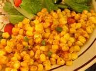 """Spicy Mexican Corn Dish """"Elote  Picoso""""  16 oz bag of frozen corn or 2 cans drained, 1 sm can roasted red chilies, finely diced 1/4 tsp cumin, 1 tsp chile powder, 1 tsp serano chile finely diced, 1 T oil, salt to taste.    Heat oile in saucepan over m heat, add corn and let heat for 5-10 minutes. Sprinkle in seasonings and chiles and cook for 5 more mins."""