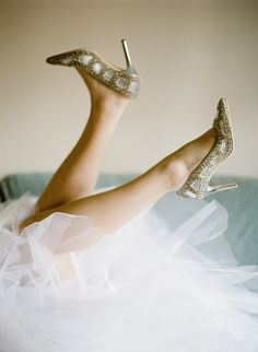 wedding day bliss :) photo by Natasha Hurley http://ruffledblog.com/winter-whites-wedding-inspiration #weddingshoes #bride #tulle