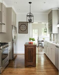 Narrow island.  Light Transitional Kitchen by TerraCotta Properties
