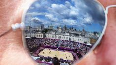 The Beach Volleyball centre court is reflected in sunglasses during Day 3 of the London 2012 Olympic Games at Horse Guards Parade.