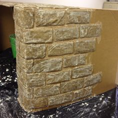 Paper mâché fireplace (prop for play) none of ours are big enough for Santa to come out of.