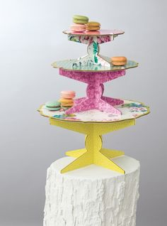Don't skimp on the dessert table. Make a statement with this floral cake stand.