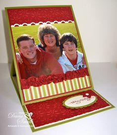 handmade Christmas card ... easel card format ... great family photo ... luv the textiure from the ruffle ribbon and embossing folder poinsettias ... red, olive, vanilla ... luv it!!