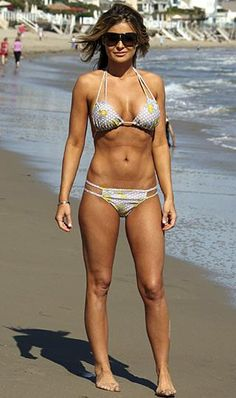 With her athletic body and Light brown hairtype without bra (cup size 36C) on the beach in bikini
