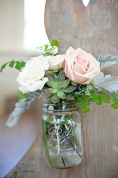 Succulents and roses in a mason jar.