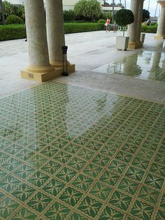 Soft Green set to a stylized floral pattern make the Tulipan pattern on this handmade cement tile we saw in the Dominican Republic just right for this patio.