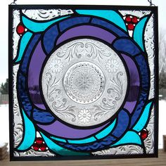 Vintage dish stained glass panel in blue, purple and aqua