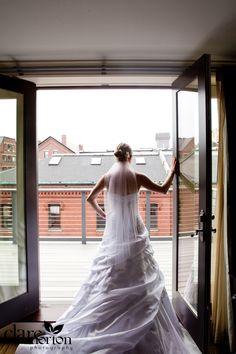 Bride overlooks the city of Portland from our Governor's Suite.