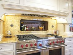 LOVE the open shelf above the stove, it has an old world look.