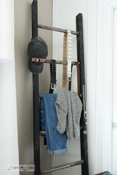 Ladder clothes rack in bedroom / part of a full summer home junk tour on FunkyJunkInteriors.net