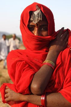 Lady in red , India
