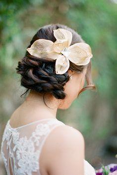 Gold mesh hair flower | @janamorganphoto | Brides.com