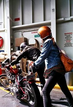 """'Give me a push babe..."""" his and hers new old school Harley hard-tail chopper, banana seat, sissy bar, ape hangers, open face helmets"""