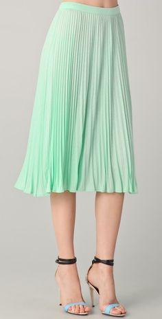 Sea foam green, long, pleated skirt.