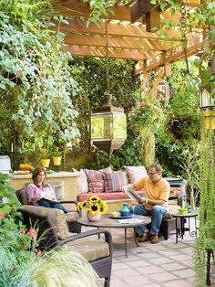 Make Your Patio an Extension of Your Home  Create an ultra-comfortable space by adding the same comforts you enjoy in your living room.  -- Outdoor furniture with plush cushions provides a great place to relax.  -- A vine-covered pergola casts shade and provides protection from rain.  -- A stylish lantern suspended from the pergola adds extra light at night.  Click here for more pergola ideas.