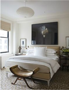 love the mix: upholstered bed + statement piece of art + hotel bedding. Via Design Stiles.