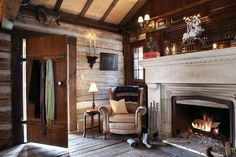 Redesign of a 19th century log cabin - the focal point of the cabin is the giant, breathtaking limestone fireplace featuring magnificent craftsmanship and detailing. (stlouishomesmag.com)