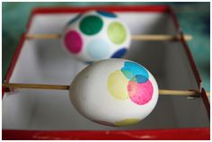 Use skewers laid across shallow slits in a shoe box to securely decoupage Easter eggs. No more dirty fingers! AWESOME!