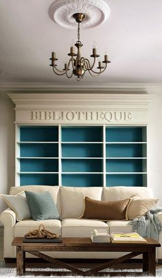 I love love love the idea of putting a saying above the bookcase - maybe Ex Libris or Bibliotheca - something Latin.