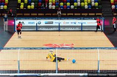 Jen Armbruster of USA tosses a goal-shot against Sweden at the 2012 Paralympic Games in London.
