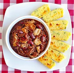 Pulled Pork Chili with Cheddar Green Onion Cornbread - Here's a terrific way to stretch a big batch of pulled pork into another delicious meal, simply by adding it to a simple chili recipe.