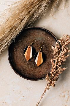 "Make a statement in neutral tones with the ethically made Radiance Earrings from India. These earrings are handcrafted by artisans of the Asha Handicrafts Association. Sanskrit for ""hope,"" Asha provides opportunities for artisans in and around Mumbai."
