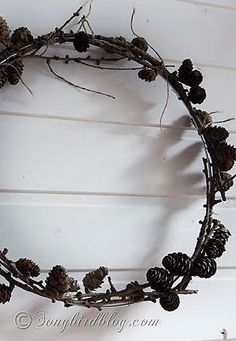 Mini pine cones wreath on a Fall mantel. See more details at www.songbirdblog.com