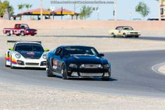 Troy Ladd's Ford Mustang leads Betim Berisha's Porsche around Spring Mountain Motor Ranch during the warm-up laps for the BFGoodrich Hot Lap Challenge at the 2013 #OUSCI