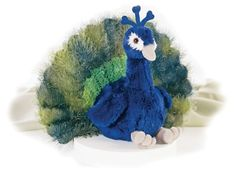 Perry the Peacock (Flopsie) at theBIGzoo.com, an animal-themed store established in August 2000.