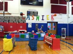 Display your teacher wish boxes so they create checkout lines.  Shoppers will not miss the teacher picks!