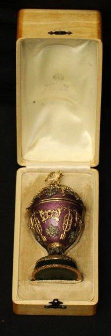 "Henrik Wigstrom (1862-1923) Faberge egg with double headed eagle finial, diamonds and precious stones placed throughout possibly ruby. Interior of lid covered in velvet with rabbit resting in center, interior of lid is marked with the Faberge marking and ""H.W."" ""56AP"", bottom of egg is marked with ""H.W."" ""56AP"" measuring 5""T, in original Faberge box."
