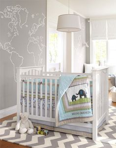 Grey & teal nursery with elephants.  Too grey and geometric for us, but could it be re-envisioned in pale blue and green?